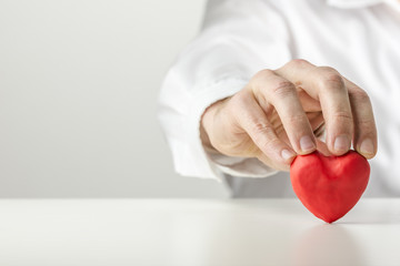 Man holding a Valentine symbolic red heart