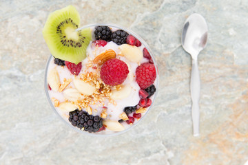 Frozen parfait dessert with berries and nuts