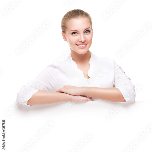 studio shot of beautiful young smiling woman