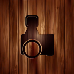 Photo camera icon. Photography. Wooden texture.