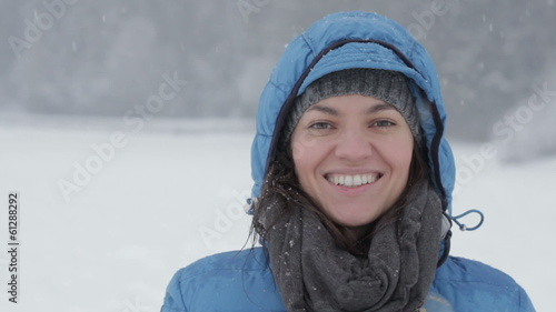 Portrait of young smiling woman in winter