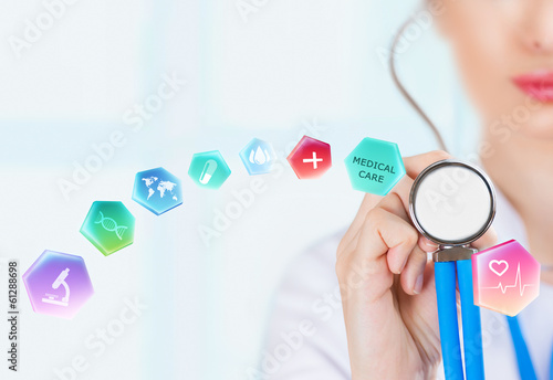 Medicine doctor hand holding stethoscope and working with modern