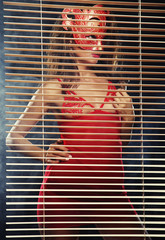 attractive woman in red with mask
