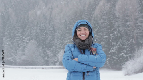 Portrait of a young woman in winter park