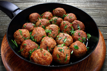 Fried pork meatballs in frying pan