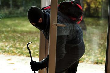 Burglar entering to house