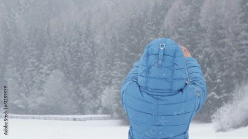 Woman uses a smartphone to video a beautiful view, slow motion