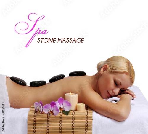 Spa Stone Massage. Beautiful Blonde Getting Hot Stones Massage