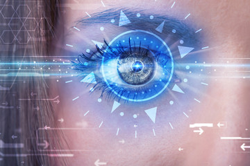 Cyber girl with technolgy eye looking into blue iris