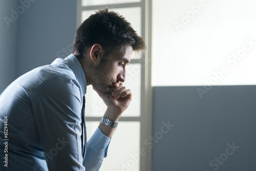Tired pensive businessman