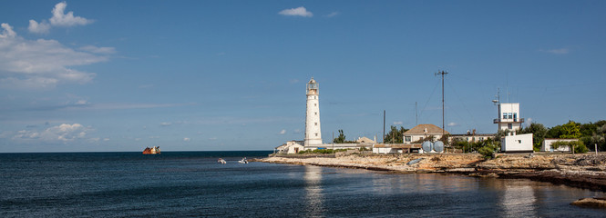 lighthouse in the sea bay