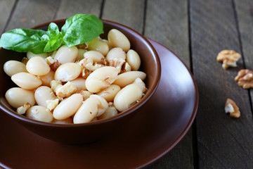 side dish of white beans with nuts