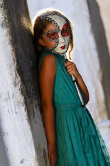 Venice, Italy - portrait of lovely girl with carnival mask