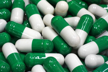 green and white capsules close up 1