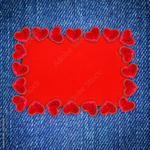 Decorative hearts and a blank form for greeting jeans background