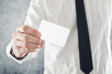 Businessman holding blank credit card