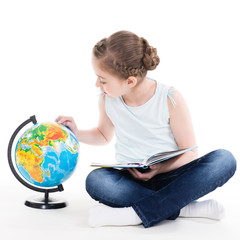 Portrait of a cute little girl with a globe.