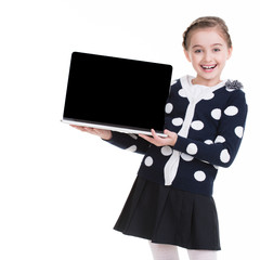 Portrait of little girl with laptop.
