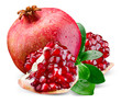 Juicy pomegranate and its piece with leaves. Isolated on a white