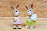 Ceramic rabbits with egg an a flower