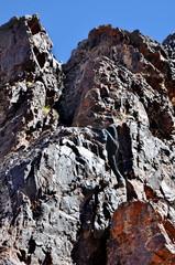 Young man climbing mountains