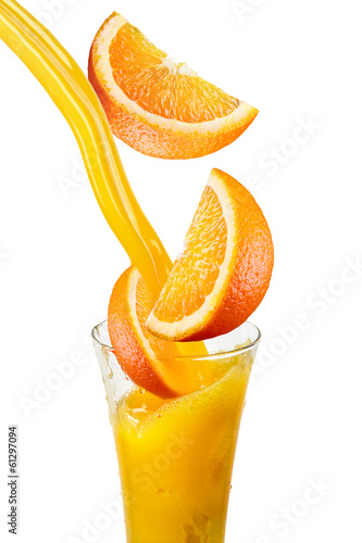 Orange juice with falling fruits isolated on white