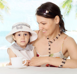 Portrait of a cute mom with baby