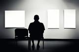Man sitting in art gallery