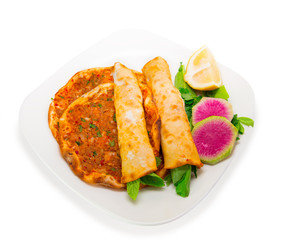 Turkish specialty lahmacun (pizza) with parsley and lemon