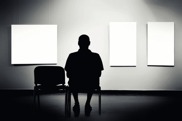 Man sitting in art gallery