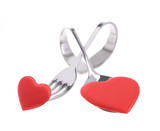 Red heart with fork and scoop on white background