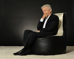 Businessman sitting in armchair