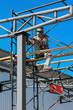 Workers welding steel structures with hight area