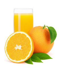 Orange juice and oranges with leaves.