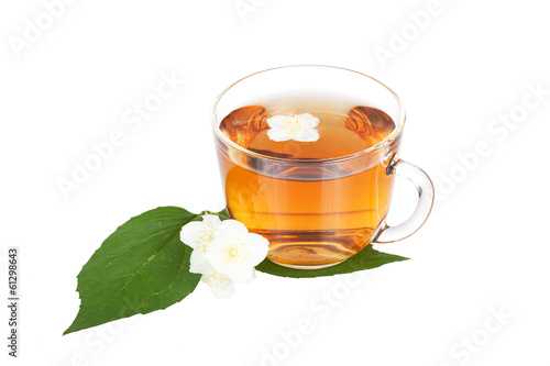 Transparent cup with tea with a jasmine