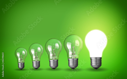Row of light bulbs.Idea concept on green background.