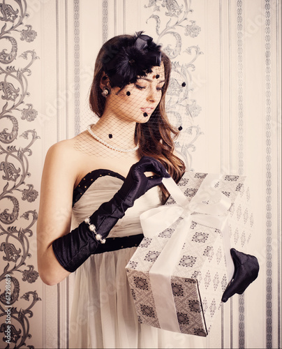 beautiful vintage woman holding gift