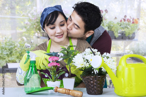 Asian couple gardening