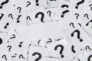 Blank paper with question marks