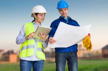 Foreman and student with blueprints