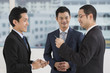 Two business men exchanging business cards