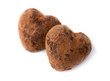 Two candy truffle heart shaped. Symbols of Valentine's Day.