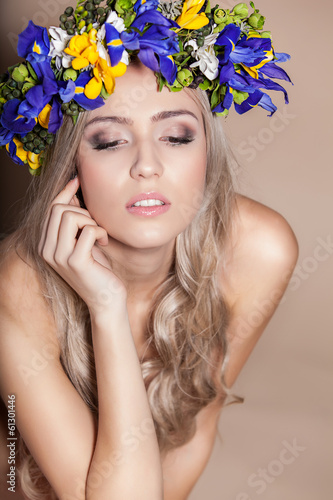 Young woman with her eyes shut and flowers in her hair