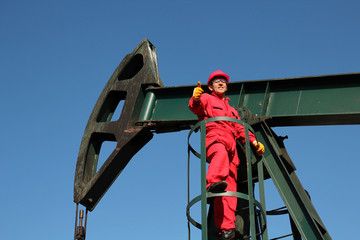 Successful Oil Worker at Work Showing Thumbs Up.