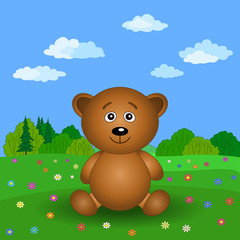 Teddy bear on a summer flower meadow