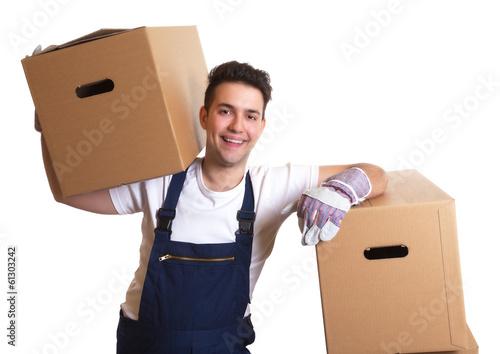 Leinwandbild Motiv Lachender Möbelpacker bei der Arbeit