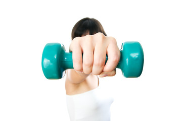 Girl with green dumbbells in hand
