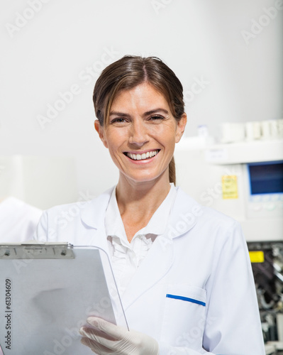 Scientist Holding Clipboard In Laboratory