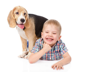 boy has fun with a puppy. isolated on white background