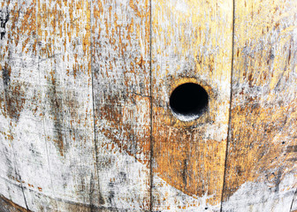 old wine barrel with hole